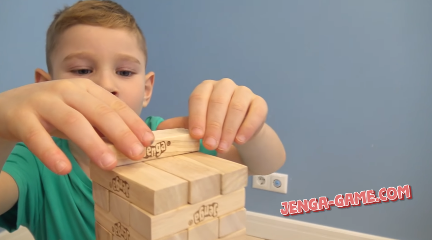 Boy is playing Jenga Game